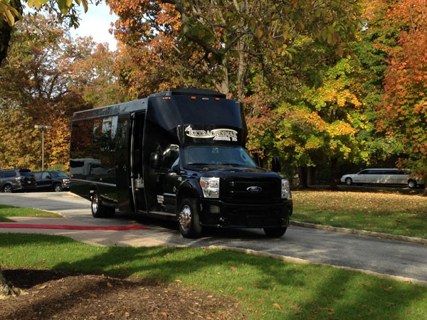 26 passenger black limo bus exterior