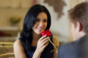 women sniffing flower